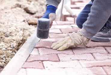 Paver bricks settings by rubber hammer